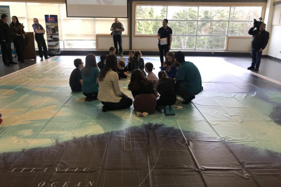 Students from Katie Bartlett's Grade 4 class at Topsail Elementary in Conception Bay South, N.L., check out Can Geo Education's new Giant Floor Map of their province at Manuels River Hibernia Interpretation Centre on March 2.