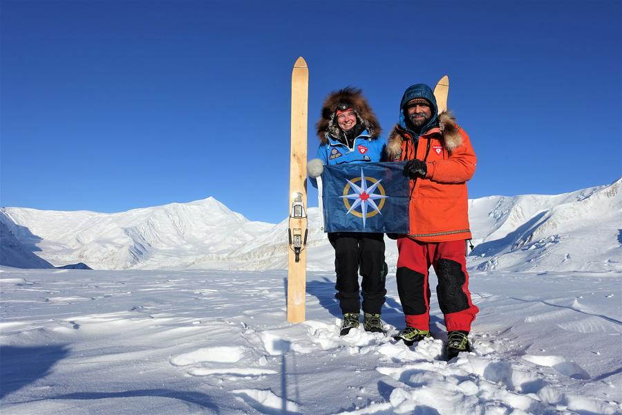 Pascale Marceau, left, and Lonnie Dupre hold the flag of the RCGS during their attempt to summit Mt. Lucania