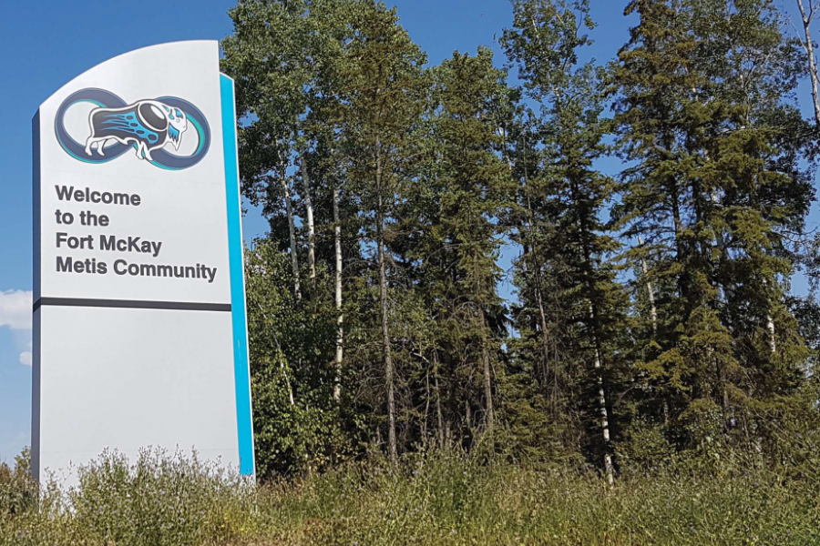 "A sign that reads ""welcome to the Fort McKay Metis Community"""