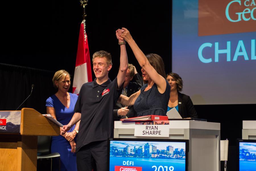 Adventurer Mylène Paquette, host of the 2018 Challenge final, celebrates with national champion William Chapman