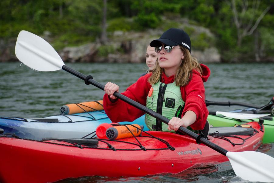 Students paddling kayaks on the St. Lawrence River