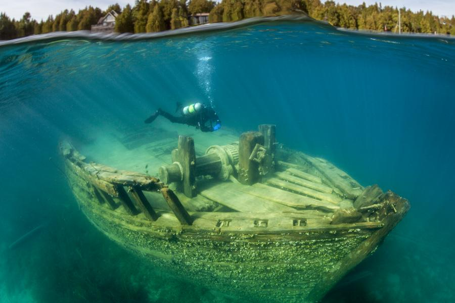 A scuba diver at a shipwreck in Fathom Five National Marine Sanctuary