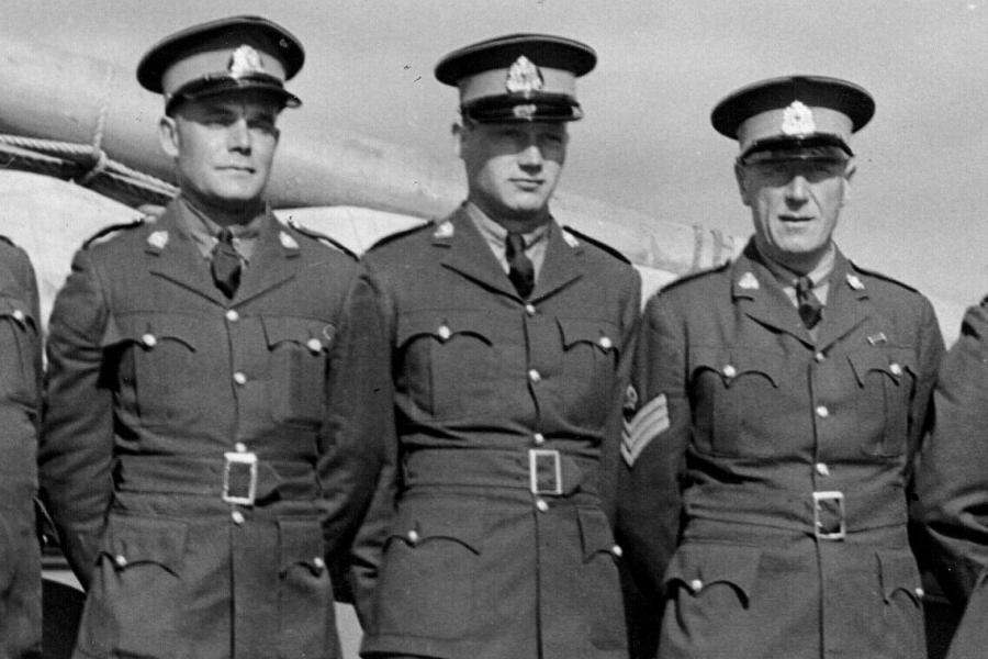 Dean Hadley, centre, was the youngest crew member aboard the RCMPV St. Roch when schooner sailed through the Northwest Passage in the early 1940s. (Photo: VMM. Leonard McCann Archives. Parks Canada St. Roch Photograph Collection. HCSR-40-18. 1942 crew in uniform.)