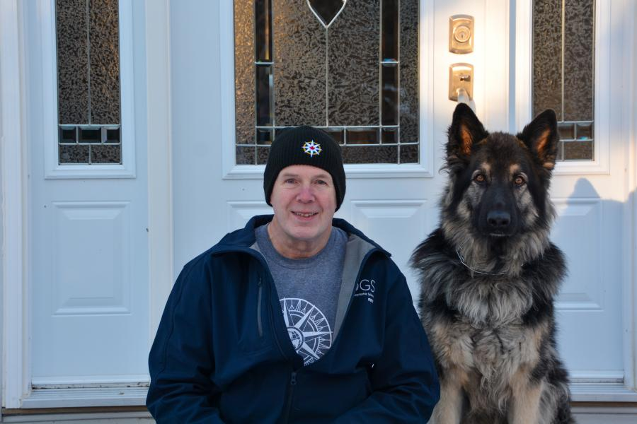Nova Scotia geography teacher John Trites with his dog Atlas