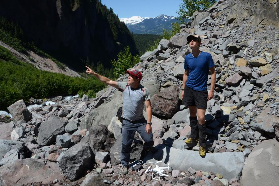 Volcanologists Steve Quane and Alex Wilson get ready to launch a drone to survey a volcanic dam
