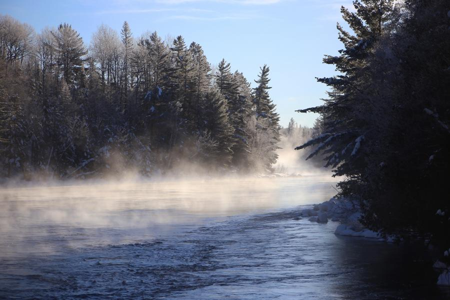 Mist rises from the Kipawa River, framed by frosty trees