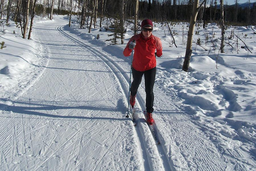 Denise Chisholm, a member of the Whitehorse Cross-Country Ski Club, glides along a trail near the facility in April