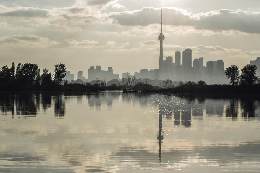 Toronto city skyline misty with lake in foreground