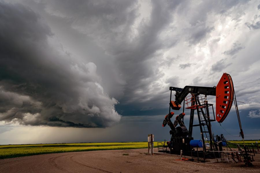 Storm clouds are seen over a pump jack rig