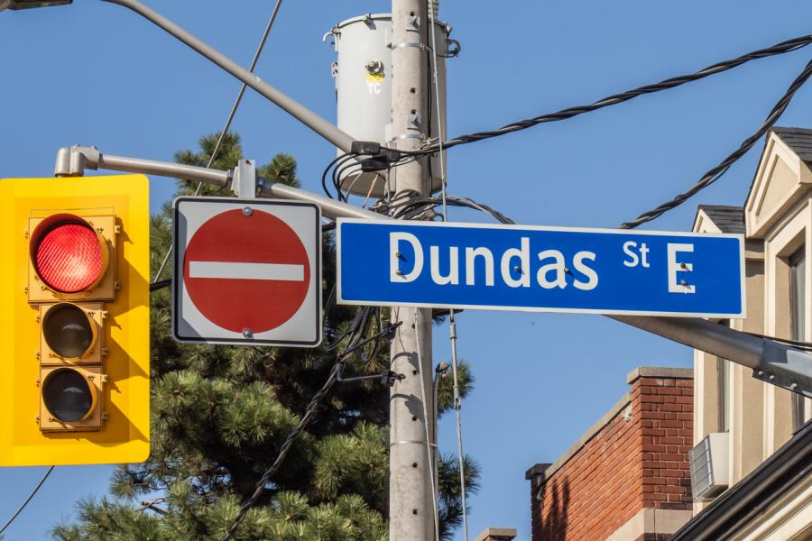 Dundas street sign with stop light and stop sign