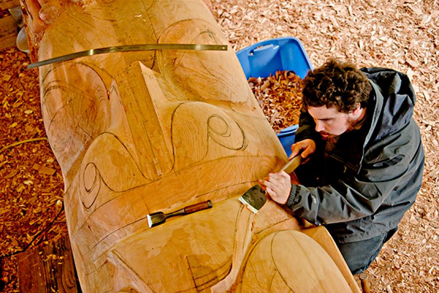 Jaalen Edenshaw works on the new totem pole