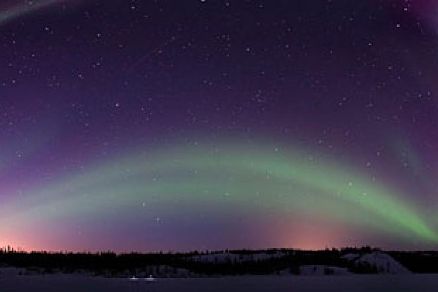 An aurora dances in the night sky