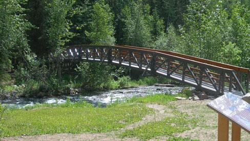 Bridge over Driftwood Creek at the start of an interpretive trail in Driftwood Canyon Provincial Park, B.C.