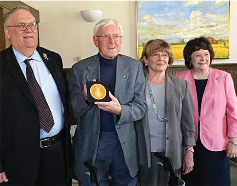 Left to right: Alberta Lt.-Gov. Donald Ethell, Derald Smith (with his Massey Medal), Nancy Smith and Linda Ethell