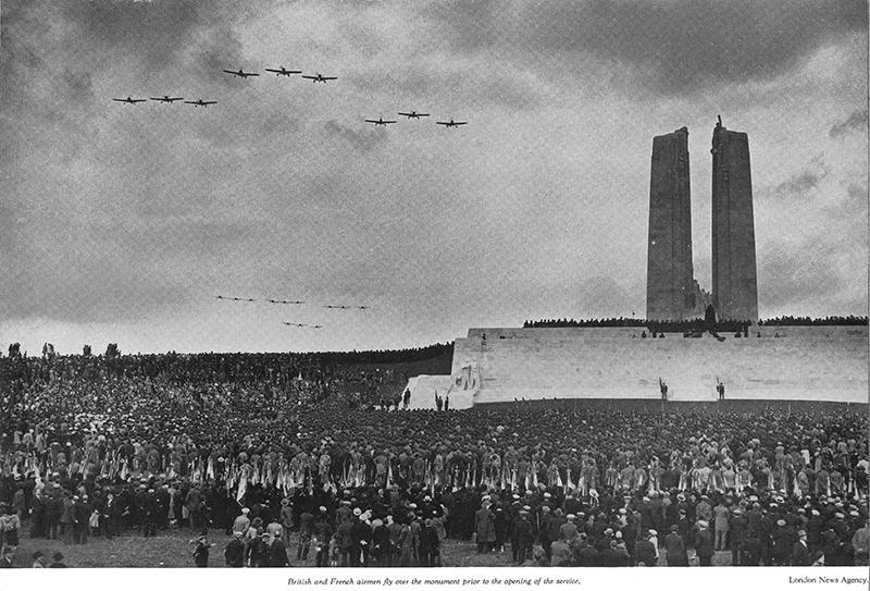 British and French airmen fly over the monument prior to the opening of the service