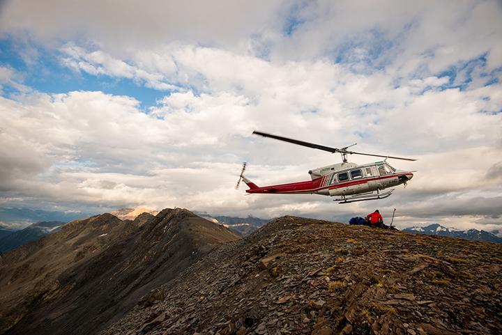 Alpine heli approaches Powder Pig Ridge for an evening shoot