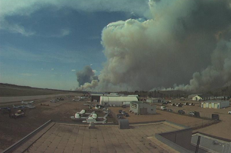 A still shot from the Fort McMurray International Airport webcam showing explosive development of the fire near the city on the afternoon of May 4th.