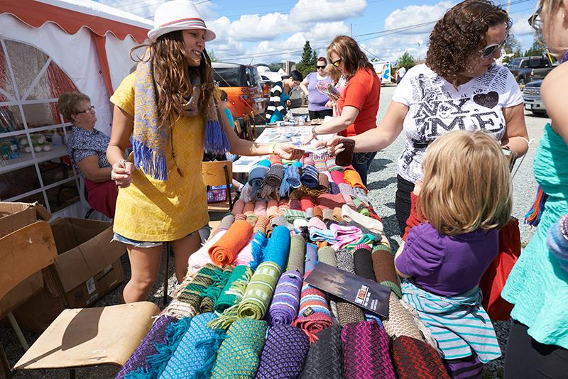 Local arts and crafts vendors set up at the entrance to the festival.