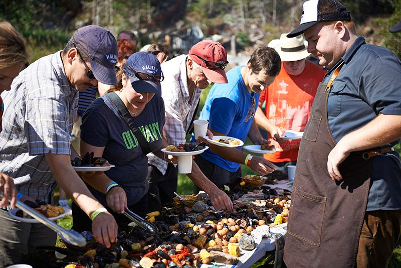 Chef Mark McCrowe serving guests on the Chef's Hike to Winterhouse Cove