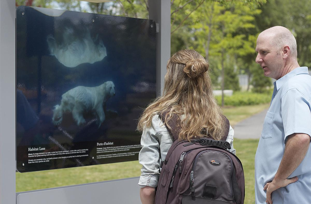 Grant Gilchrist and daughter Caitlin view the Climate Change is Here exhibition
