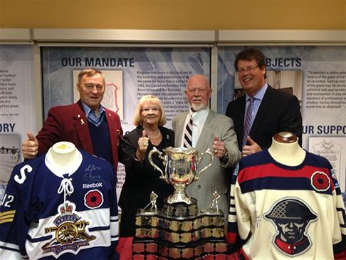 Mark Potter, President of the International Hockey Hall of Fame, Mel and Bev Price, and Don Cherry pose with the Memorial cup