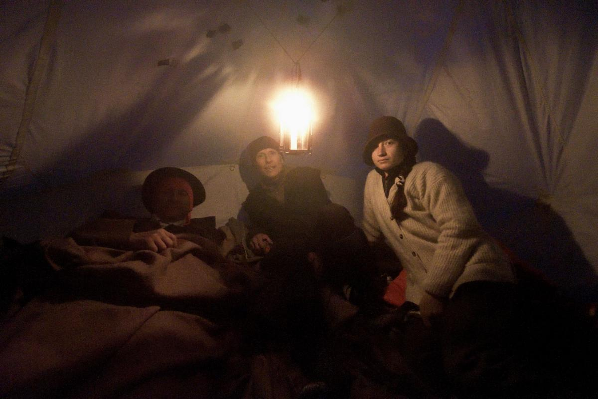 Rob LeBlanc, Garry Reiss and Natalia Danalachi settle down for a cold night before their first summit attempt