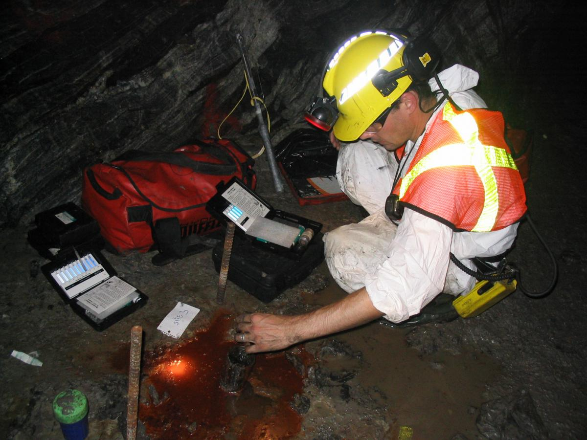 A researcher samples subterranean water deep in a mine near Timmins, Ont.