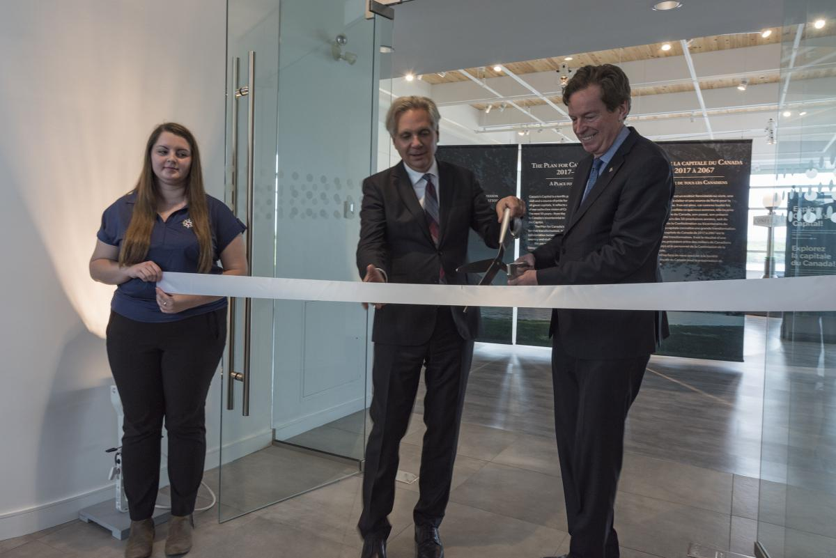 Mark Kristmanson and John Geiger cut the ribbon to officially open 50 Sussex