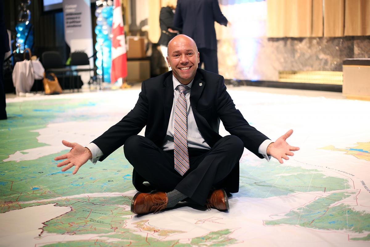 Andy Fillmore MP on CPAC Route 338 giant floor map
