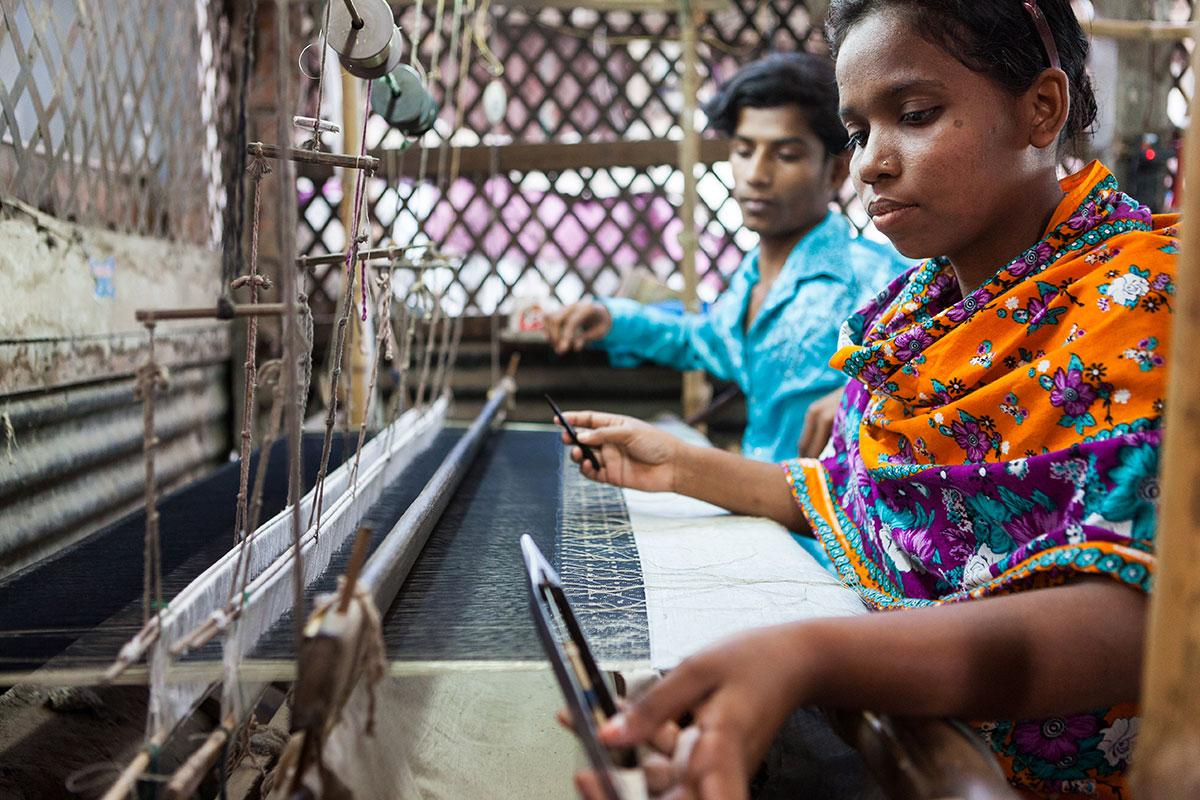A woman weaves Jamdani fabric in Bangladesh. The fabric, which UNESCO has recognized as an item that represents the intangible cultural heritage of humanity, is one of many handicrafts on the Artisan Hub website