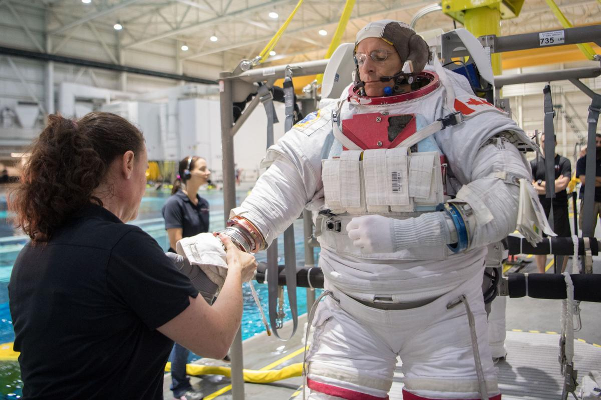 CSA astronaut David Saint-Jacques receives spacewalk training at NASA's Neutral Buoyancy Laboratory in Houston.