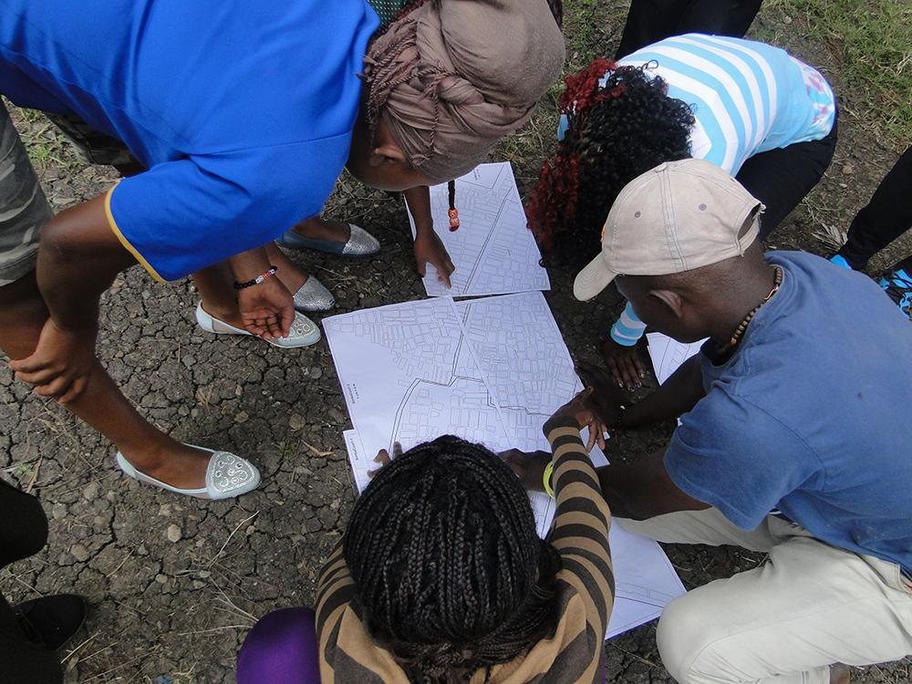 Researchers with the Akiba Mashinani Trust examine a map of Nairobi's Mukuru slum. In August 2017, activists succeeded in having the settlement designated as a special planning area, the first step in a process that could help transform the slum and the lives of its 300,000 residents.