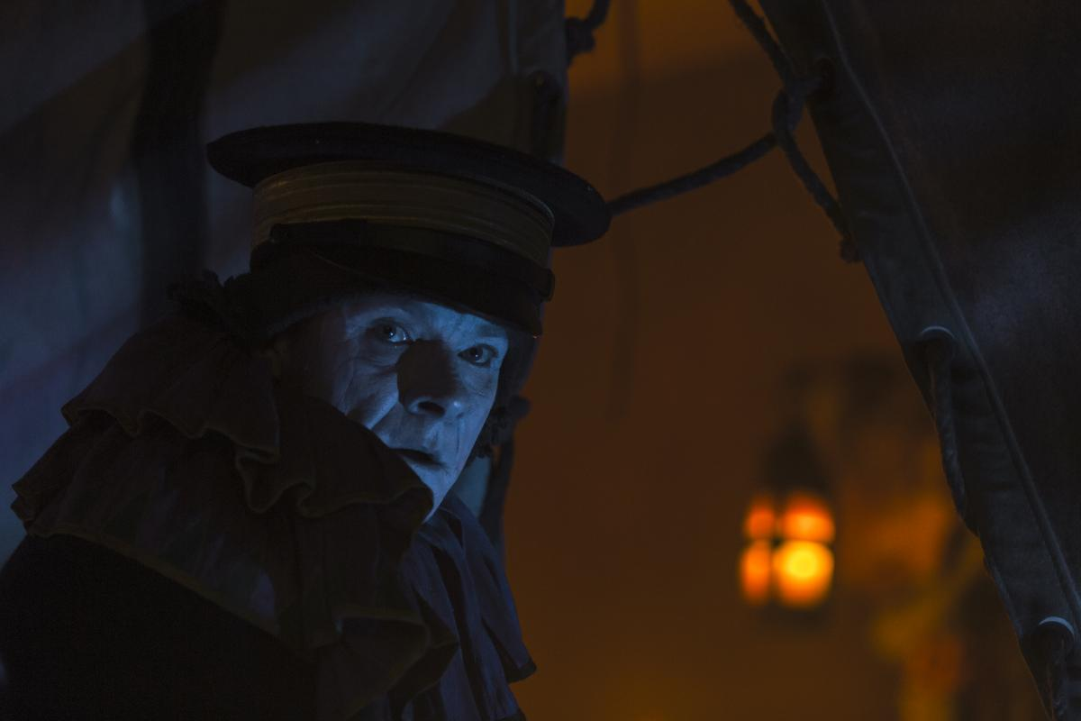 A haunted Dr. Stephen Stanley (played by Alistair Petrie) prepares to set a horrible string of events in motion during what's meant to be a spirit-lifting carnival for the men of the Franklin Expedition. (Photo: Aidan Monaghan/AMC)