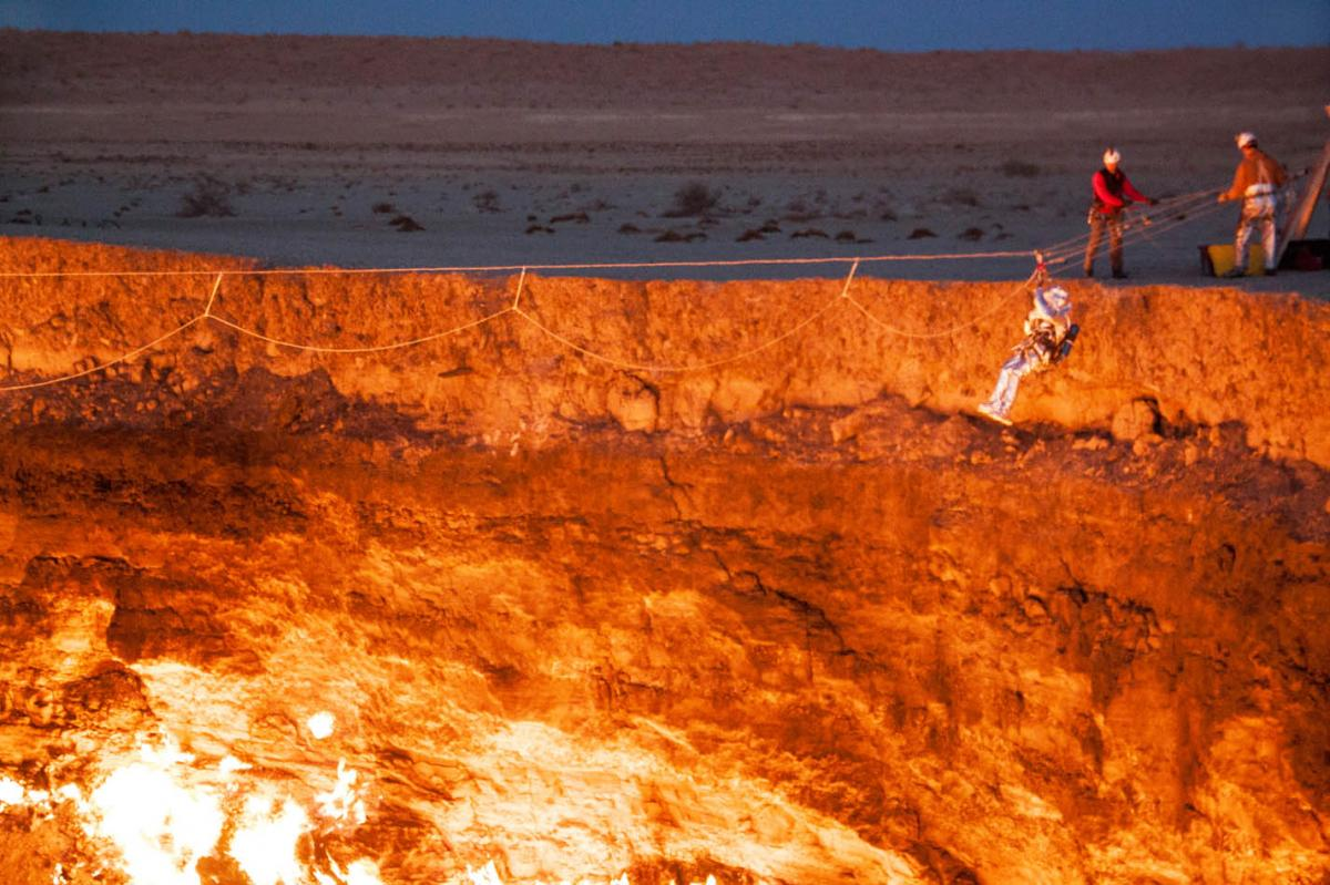 George Kourounis rappels into the Darvaza gas crater in Turkmenistan