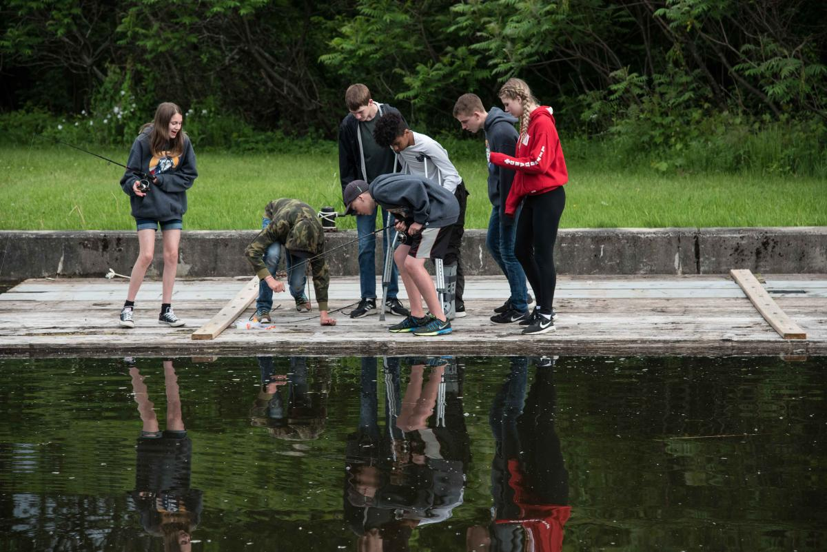Students fishing on the Rideau Canal