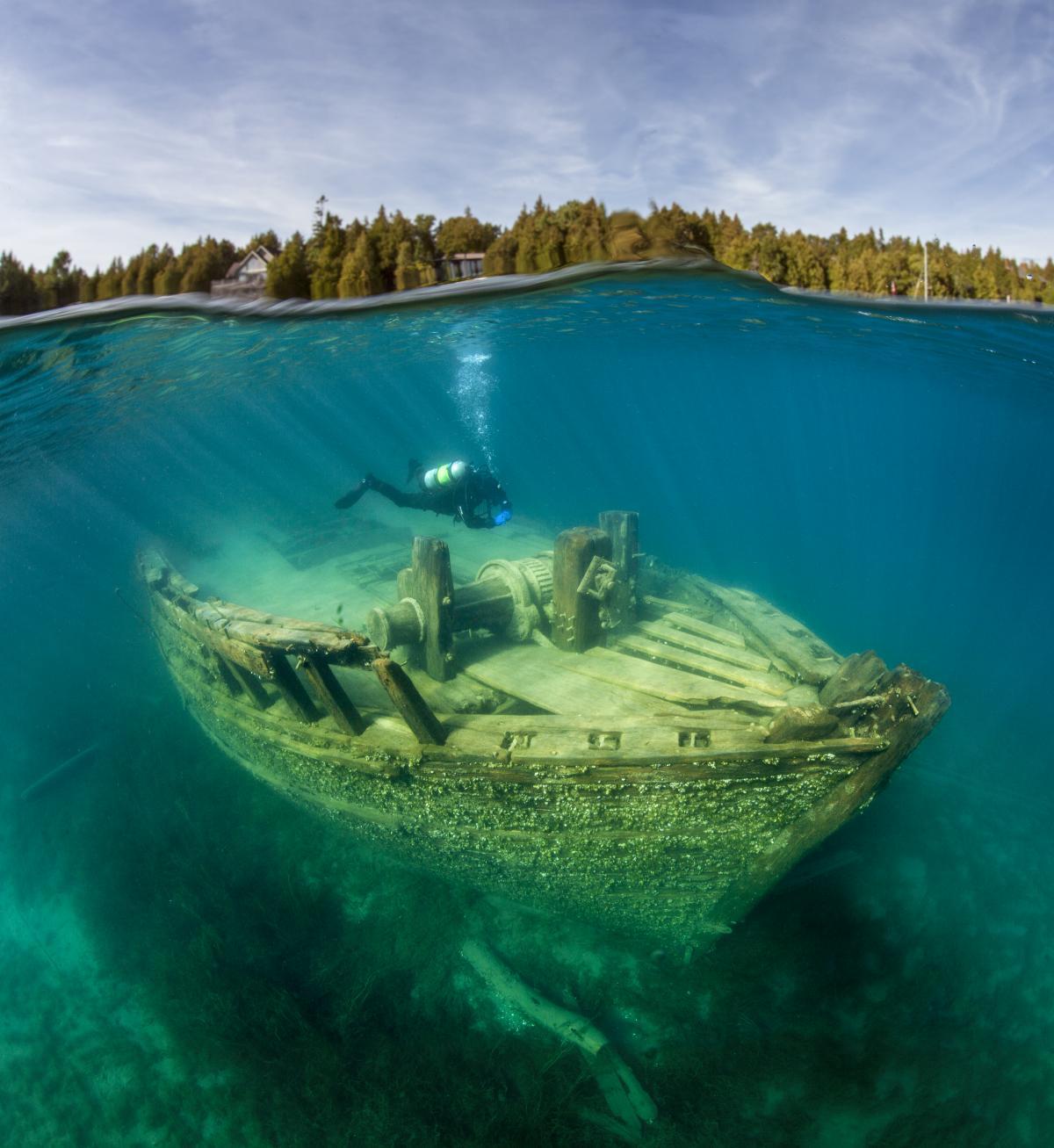 A scuba diver at a shipwreck in Fathom Five National Marine Sanctuary