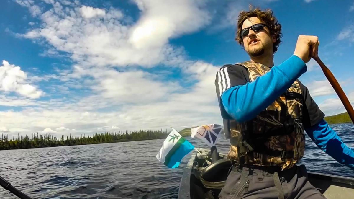 Man paddling canoe