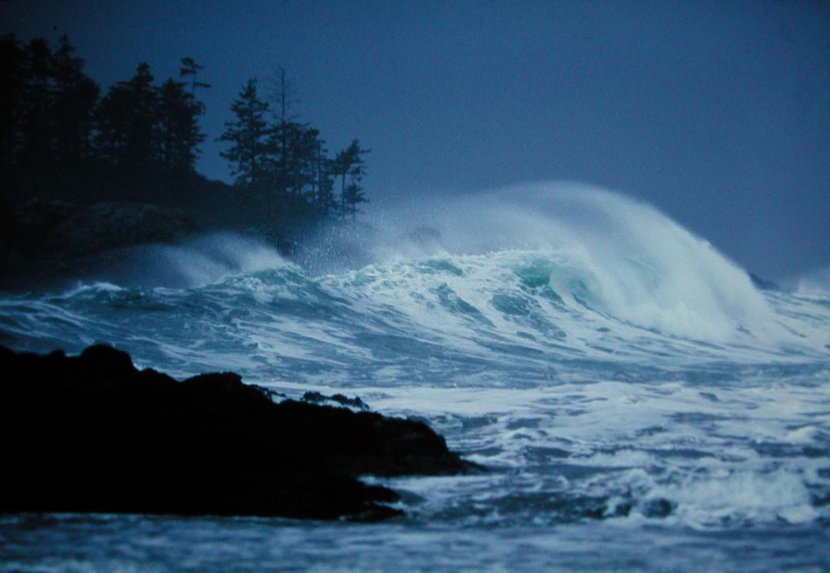 Waves crash on a Tofino beach during a winter storm