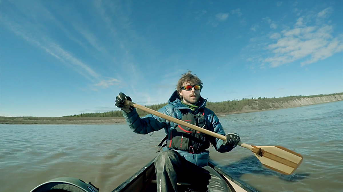 Adam Shoalts paddles against the powerful current of the Mackenzie River, N.W.T., just two weeks into the Trans-Canadian Arctic Expedition. (Photo: Adam Shoalts)