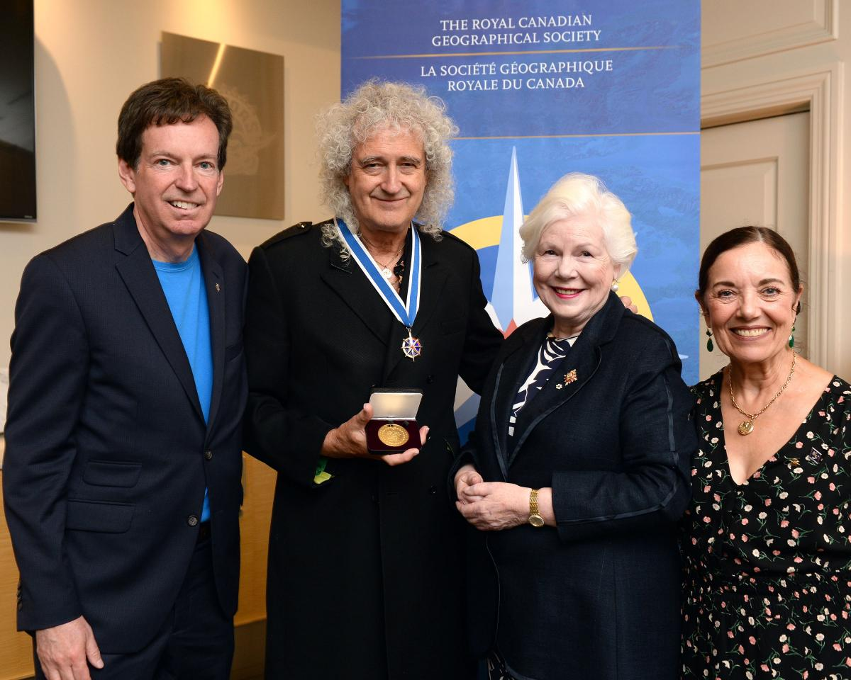 John Geiger, Brian May, Elizabeth Dowdeswell and Wendy Cecil backstage at the Scotiabank Arena on July 28, 2019