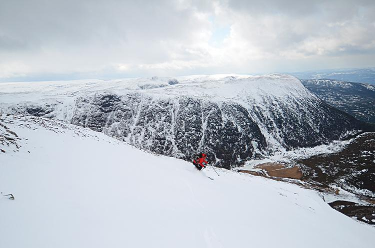 Guide Ed English pulls off a perfect turn on a high wall in Gros Morne National Park