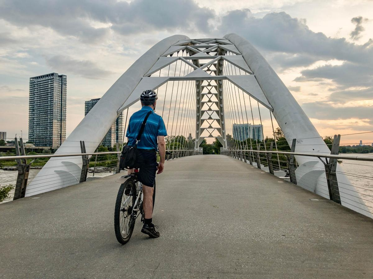 Cyclist prepares to cross bridge