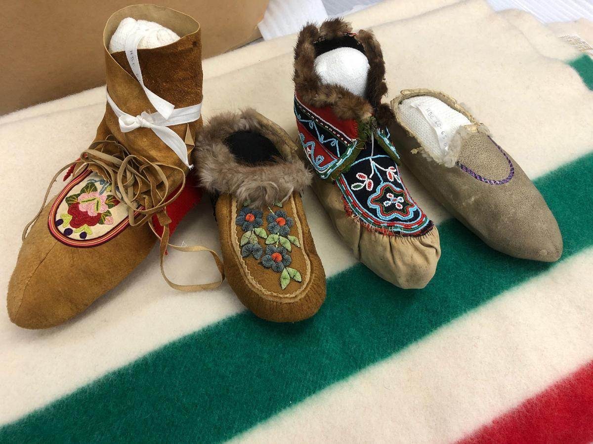 Moccasins on a Hudson Bay Company point blanket