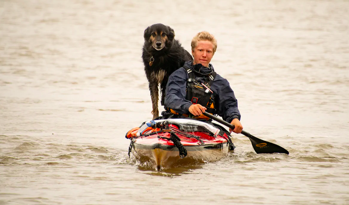 Teen and dog in canoe