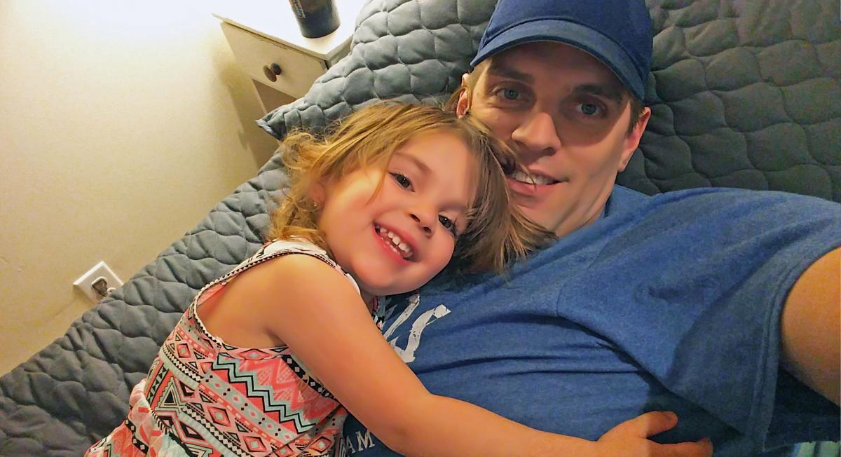 Manitoba teacher with his daughter at home