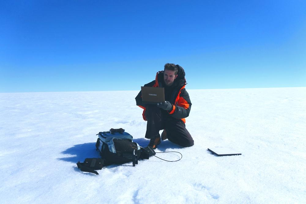 Glaciologist Joseph Cook studies microbial ecosystems on the surface of the Greenland ice sheet.