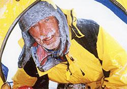 Bernard Voyer peers into a tent during his successful summit of Mount Everest in 1999