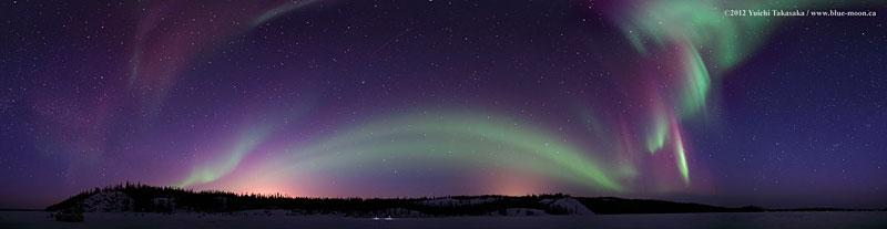 An aurora dances in the night sky